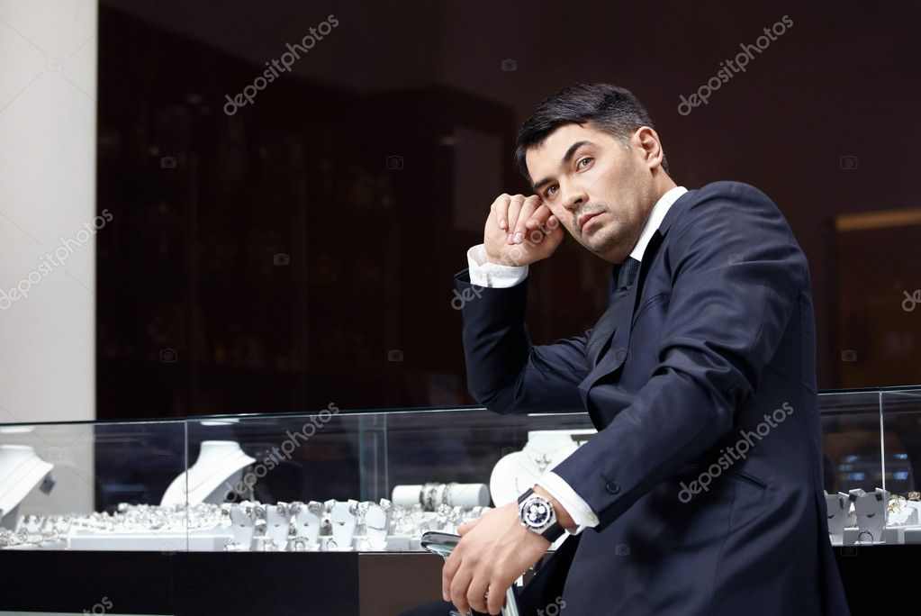 The managing director in a suit at shop show-windows — Stock Photo #4019365