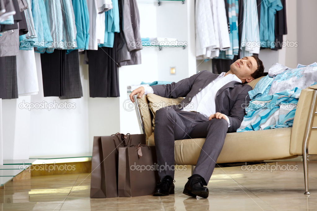 The client of shop of clothes sleeps on the sofa — Stock Photo #4019479