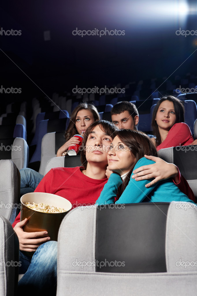 Enamoured couple at cinema in the foreground — Stock Photo #4019492