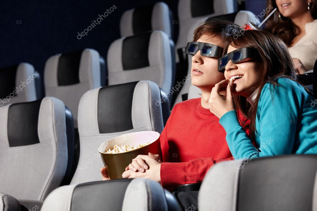 The couple with pop-corn looks cinema in 3d  Stock Photo #4019499