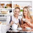 Young girls in cafe — Stock Photo