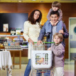 Family with purchases in shop — Foto de Stock