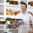 The smiling waiter - Stockfoto