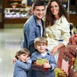 Smiling family in shop — Stock Photo