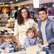 Family portrait in shop — Stock Photo