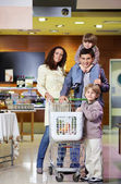 Family with purchases in shop — Stock Photo