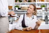The attractive girl in cafe — Stock Photo