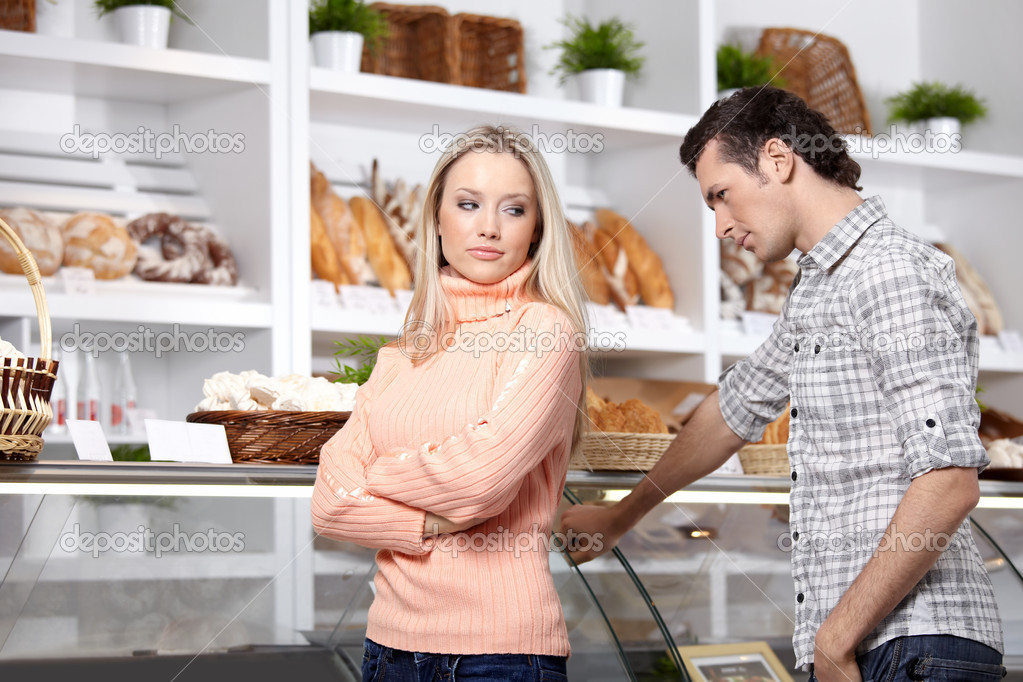 The girl and the guy in shop  Stock Photo #4021762