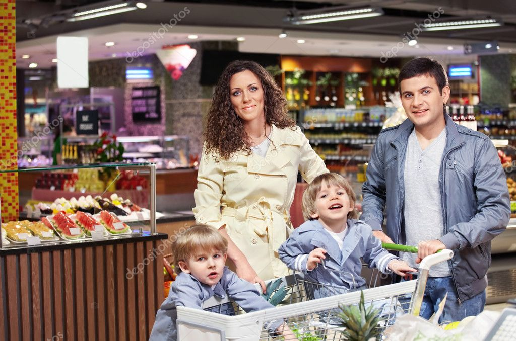 The happy family in shop looks in the chamber — Stock Photo #4022102
