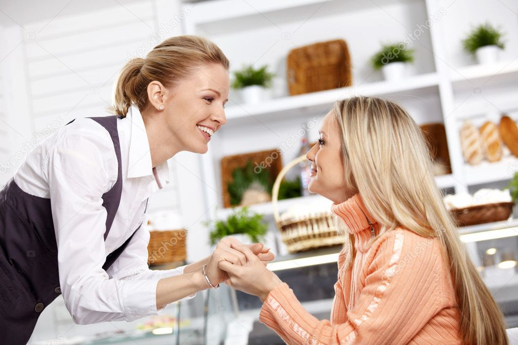 Two attractive girlfriends have met in cafe — Stock Photo #4022687