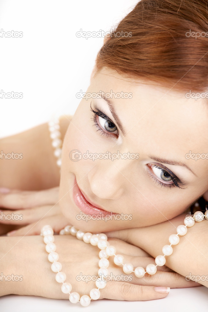 The dreaming woman with a pearl necklace on the bared shoulders — Stock Photo #4089654