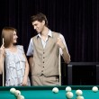 Couple in a billiard room — Stock Photo