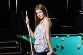 The girl at a billiard table — Stock Photo