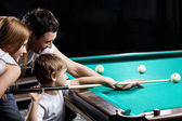 The family plays billiards — Stock Photo