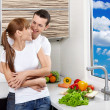 Happy couple at kitchen — Stock Photo