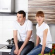 Stock Photo: Young couple at kitchen