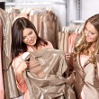 Nice girlfriends in shop — Stock Photo