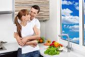 Happy couple at kitchen — Stock Photo