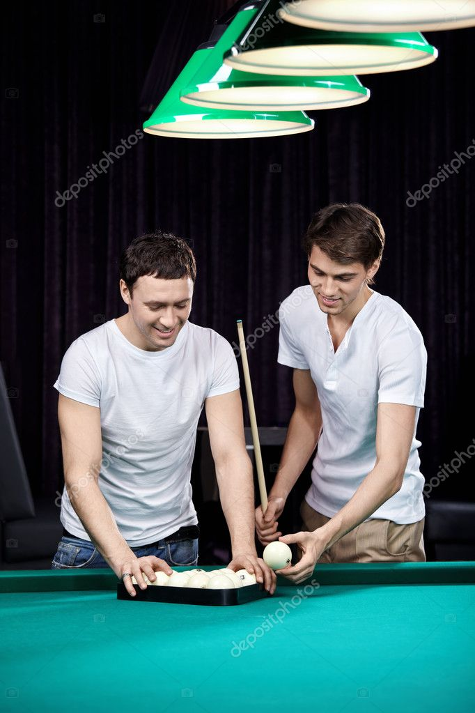 Two young men put spheres for billiards — Stock Photo #4239372