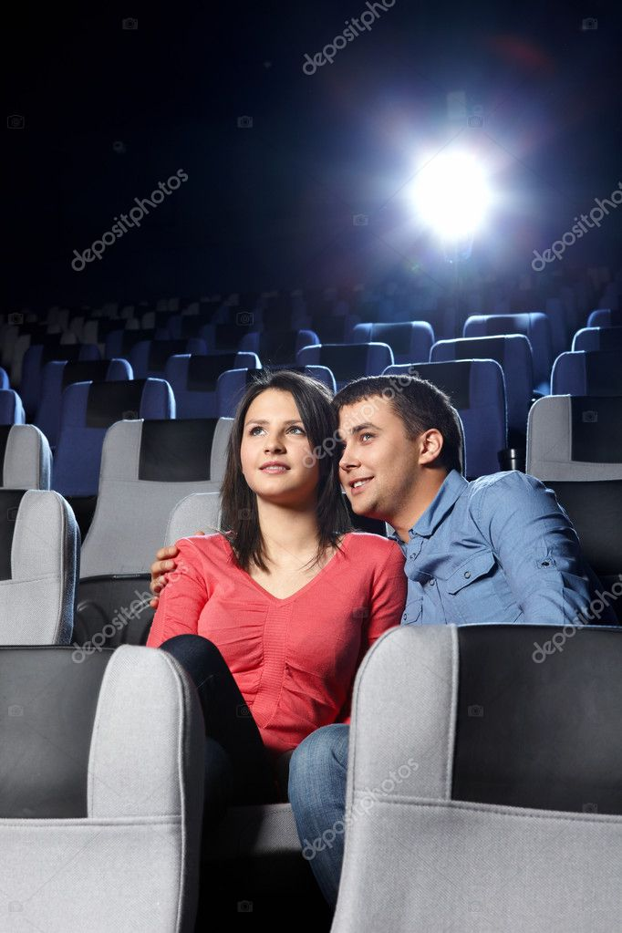 The young enamoured couple looks a film — Stock Photo #4239896