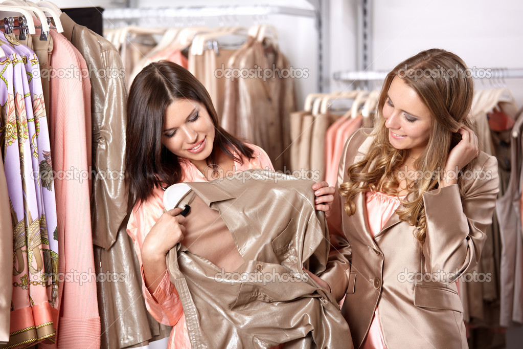 Two attractive girls try on clothes in shop — Stock Photo #4239925