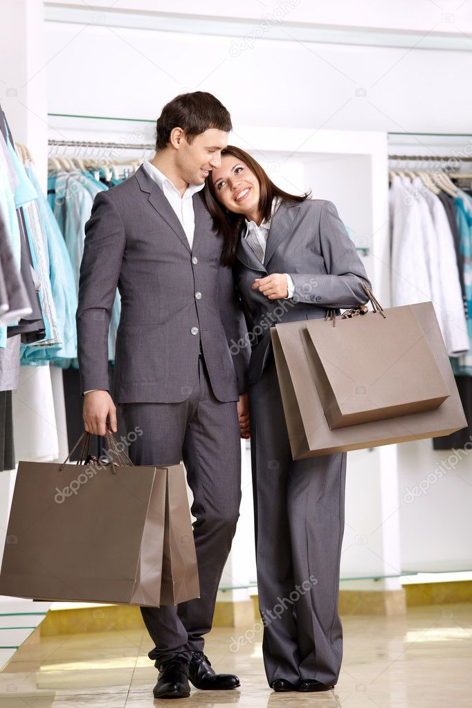 Attractive young couple with purchases in shop — Stock Photo #4239949