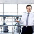 The businessman in sports hall — Stock Photo