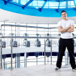 The trainer in a sports hall - Stock Photo