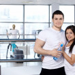 Young couple in sports club — Foto de Stock