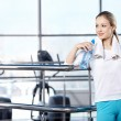 The young girl in fitness club — Stock Photo #4247308