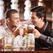 Drunken cheerful man in a pub — Stock Photo