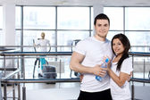 Young couple in sports club — Stock Photo