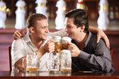 Drunken cheerful man in a pub — Stock Photo