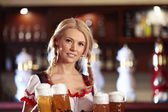 Waitress with beer — Stock Photo
