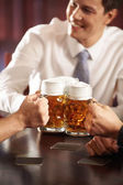 Men with big mugs of beer — Stock Photo