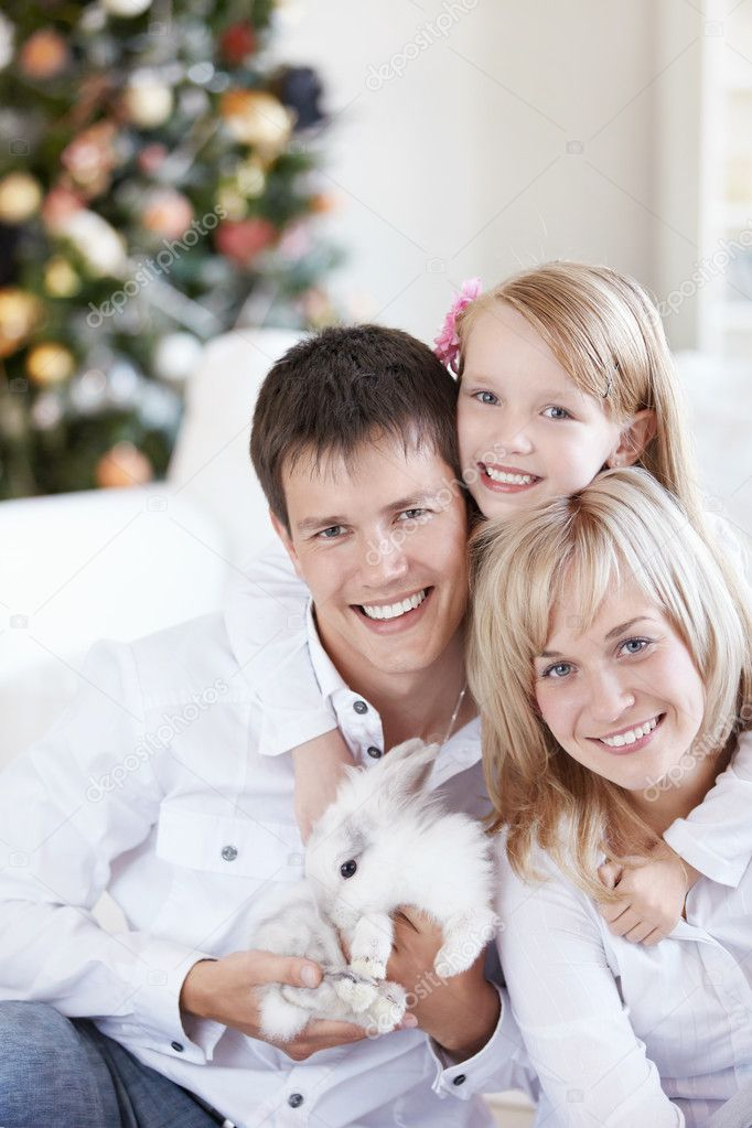 Parents with their daughter and the white rabbit — Stock Photo #4247885