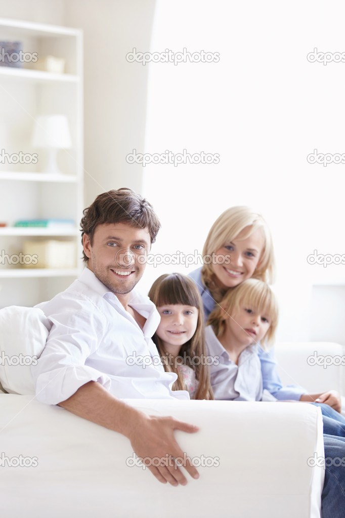 Young parents with children at home — Stock Photo #4248501