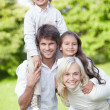 Stock Photo: Parents with children
