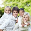 Young families with children outdoors — Stock Photo