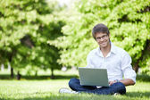 A young man outdoors — Stock Photo