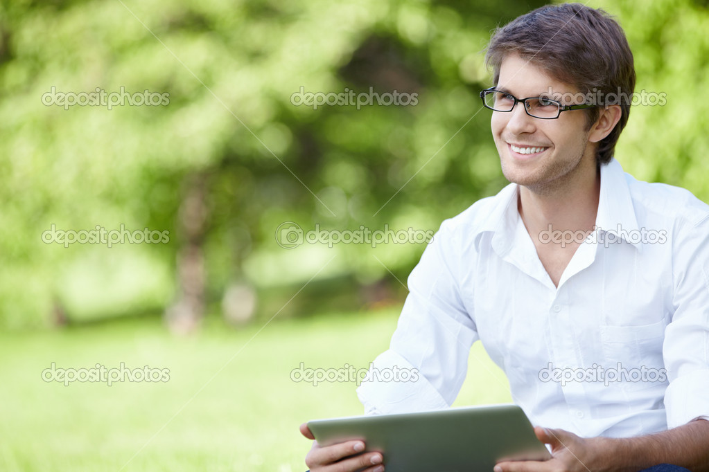 A smiling man with laptop outdoor  Stock Photo #4270826