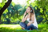 An attractive girl in the park — Stok fotoğraf