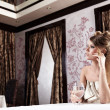 Stock Photo: The beautiful girl at restaurant