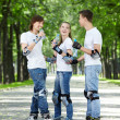 Youth on rollers in park — Stock Photo
