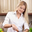 Portrait of the woman on kitchen — Stock Photo #4512143