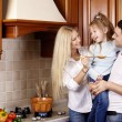 Stock Photo: Family in kitchen
