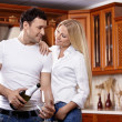 Couple with champagne on kitchen — Stock Photo