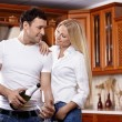 Couple with champagne on kitchen — Stock Photo #4512223
