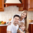 Family in kitchen — Stock Photo #4512247