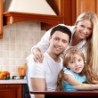 Parents with the child on kitchen — Stock Photo #4512260